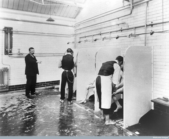 L0015468 Male patients being washe by hospital orderlies. Credit: Wellcome Library, London. Wellcome Images images@wellcome.ac.uk http://wellcomeimages.org Male patients being washed by hospital orderlies, Long Grove Asylum, Epsom. In the Royal College of Psychiatrists. circa 1930? Published: - Copyrighted work available under Creative Commons Attribution only licence CC BY 4.0 http://creativecommons.org/licenses/by/4.0/