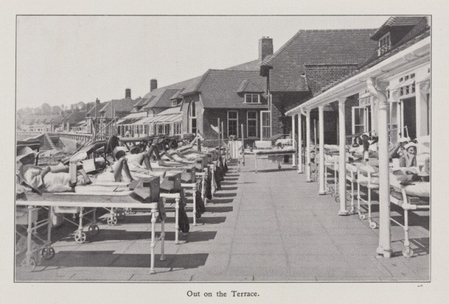 L0074520 Sun therapy at Alton Hospital Credit: Wellcome Library, London. Wellcome Images images@wellcome.ac.uk http://wellcomeimages.org Child patients lying outside in beds on a terrace outside the Hospital of Alton, Hampshire, in the sun as part of their therapy. Caption reads: Out on the Terrace Photograph 1937 Alton 1908-1929-1937 : the unconventional tribute of an outsider. Lord Mayor Treloar Cripples Hospital and College (Alton, Hampshire, England) Published: 1937] Copyrighted work available under Creative Commons Attribution only licence CC BY 4.0 http://creativecommons.org/licenses/by/4.0/